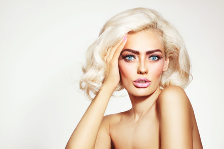 platinum hair: Vintage style portrait of young beautiful tanned sensual platinum blonde girl with stylish make-up and hairdo