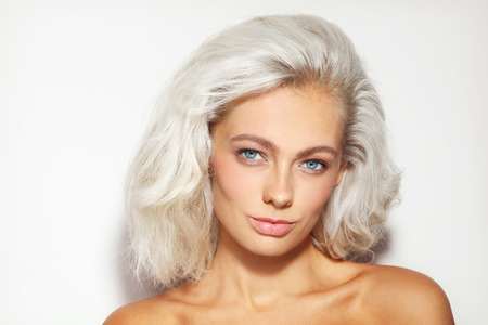 platinum hair: Portrait of young beautiful platinum blond woman with clean natural make-up