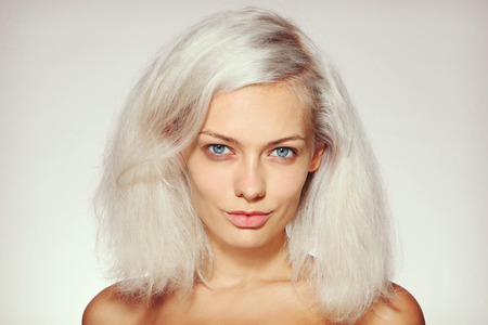 platinum hair: Vintage style portrait of young beautiful girl with platinum blond bleached hair and no make-up