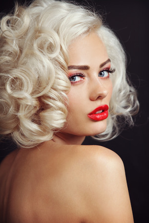 platinum hair: Vintage style portrait of young beautiful sexy blonde pin-up girl with curly hair and red lips, selective focus