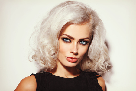 platinum hair: Vintage style portrait of young beautiful platinum blond woman with stylish make-up and curly hair