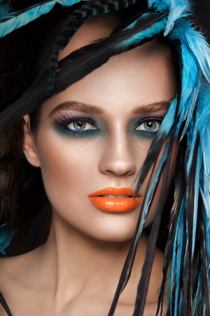 Close-up HD portrait of young beautiful woman with fancy make-up photo