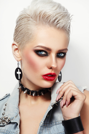 Young beautiful platinum blond woman with 80s style makeup