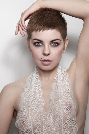 Young beautiful sexy woman with pixie haircut