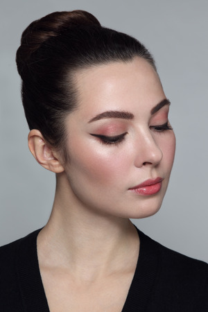 Young beautiful woman with stylish cat eye make-up