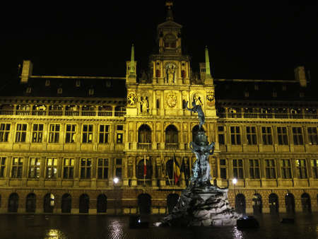 In the square in Antwerp at night, the illuminated fountain and the hall behind