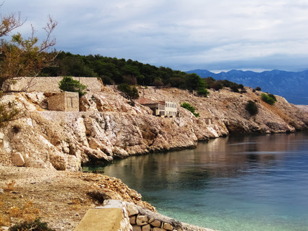 View on old ruined prisons in Naked island in croatia,at cloudy hot day across the coast