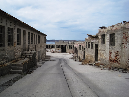 View on old ruined prisons in island Naked in croatia,at cloudy hot day