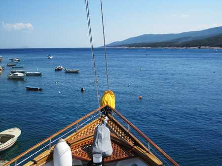 View from bow of sailing ship on hills of city Rabac in summer at sunny day Reklamní fotografie