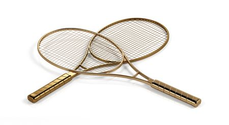Two gold tennis rackets. Stock Photo