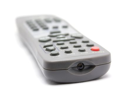 TV remote control isolated on white background. Selective focus limited to front objects.