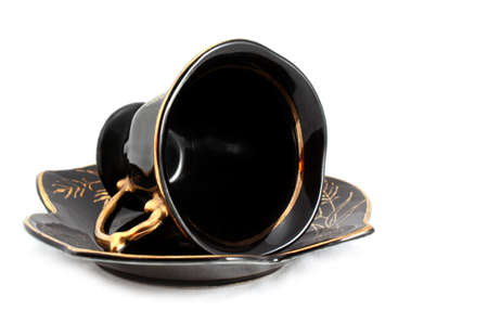 Black cup and saucer Stock Photo