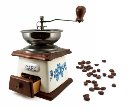 maker: Vintage coffee mill with coffee beans