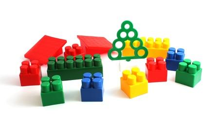 Child toy bricks construction on white background Stock Photo
