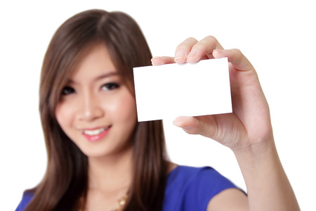 Beautiful young Asian woman with nice smile showing blank business card ready to use, on isolated white background photo