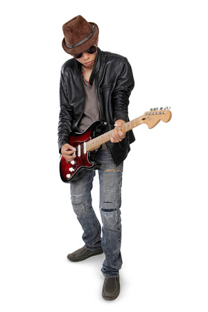 full metal jacket: Young handsome musician playing electric guitar with cool attitude, isolated on white background