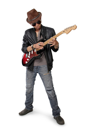 Young rock guitarist practicing tapping technique on electric guitar isolated on white background