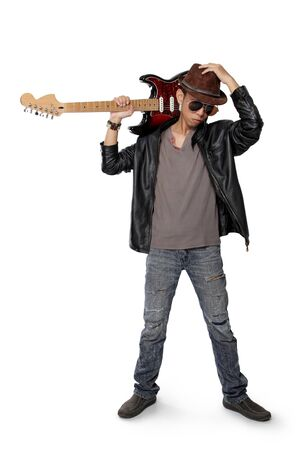 jazzy: Young rock guitarist carrying electric guitar on his shoulder isolated on white background Stock Photo