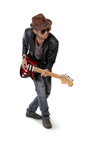 jazzy: Young rock guitarist play his guitar in cool attitude isolated on white background