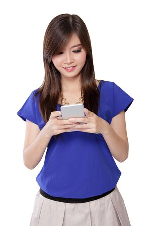 Cute Asian girl smiling while texting with her smart phone , isolated on white background photo