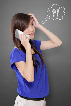 Young Asian woman scratching her head in confusion while talking on cell phone, with comical question and exclamation mark doodles on gray background