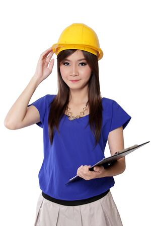 Portrait of young architect woman holding her yellow safety helmet, isolated on white background photo