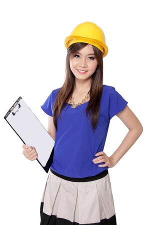 Portrait of smiling young architect woman in yellow hard hat holding work plan sheet, isolated on white background photo