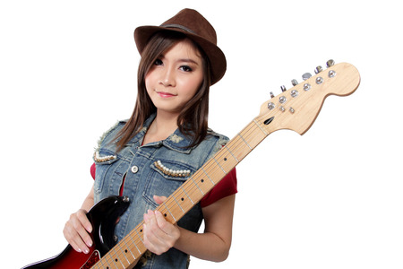 Beautiful Asian Punk Rocker Girl In Jeans Jacket And Fedora Hat Posing With Her Electric Guitar