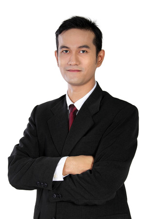 Portrait of young confident Asian businessman standing with crossed arms pose isolated on white background Stock Photo