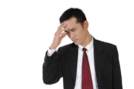sweaty: Young Asian businessman feeling unwell, with one hand on his sweaty forehead, isolated on white background Stock Photo