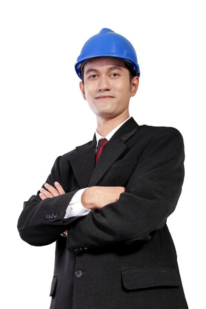 architect: Low angle portrait of young Asian architect in formal wear posing with crossed arms, isolated on white background
