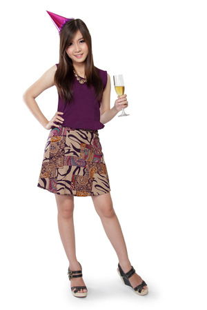 party hat: Full body of cute Asian party girl standing pose to camera, isolated on white background Stock Photo
