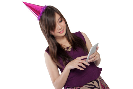 girl dress: Pretty Asian girl in party costume smiling while using her smartphone , isolated on white background