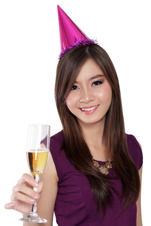 pointy hat: Portrait of happy Asian girl dressed up in party style raise her champagne glass, isolated on white background