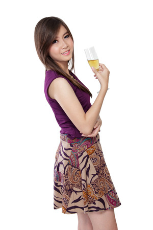sweet smile: A fashionable Asian girl in purple dress pose with a glass of champagne, isolated on white background Stock Photo