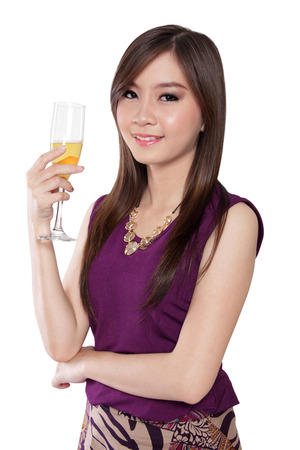 nicely: Portrait of nicely dressed Asian girl holding a glass of champagne in elegant style, isolated on white background Stock Photo
