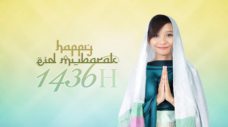 Religious theme widescreen background for Islamic New Year 1436 H. Composition of typography design and muslim girl image. Archivio Fotografico