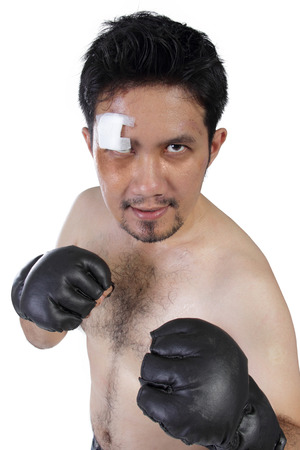 opponent: MMA fighter with challenging stare at his opponent, isolated on white background