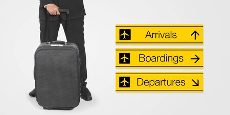 arrivals: Conceptual business trip image: composition of businessman, suitcase, and airport signboard.
