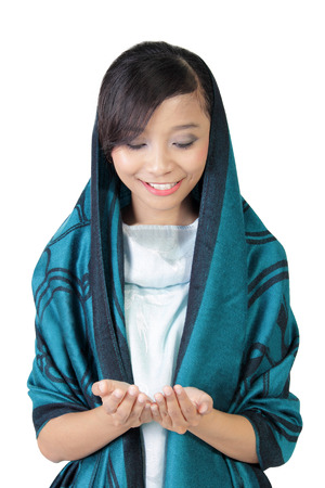 fashionable girl: Portrait of smiling Asian muslim girl looking at her open hands, isolated on white background