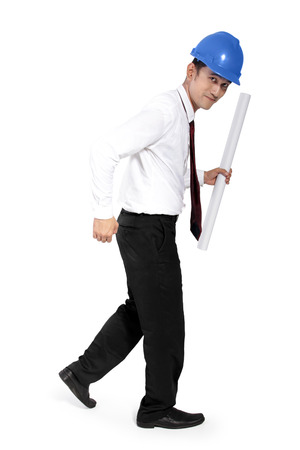 moonwalk: Attractive Asian construction worker holding a paper scroll and walking, full body shot, isolated on white background