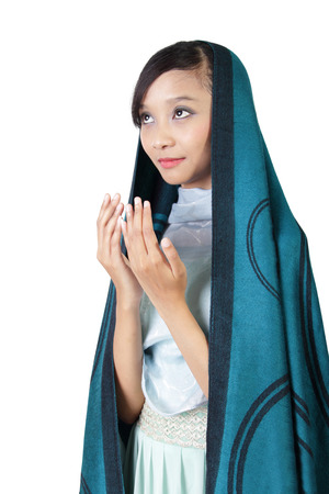 bismillah: Portrait of young Asian muslim  woman praying, isolated on white background