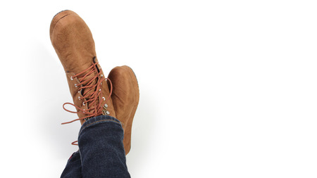 women in boots: A pair of brown women boots in relax pose, isolated on white background