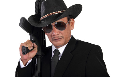 cartel: Close up face of old gangster holding a gun, isolated on white background