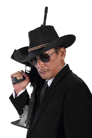 scoundrel: Side view face of old gangster holding a gun, isolated on white background