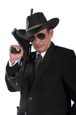 scoundrel: Portrait of old gangster holding a gun, isolated on white background