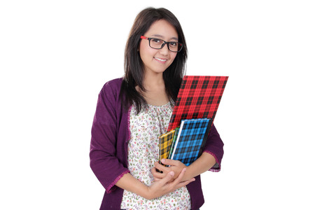 middle class: Friendly Asian librarian woman pose with some books and smile to camera, isolated on white background