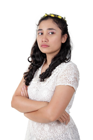 enmity: Portrait of antagonist Asian lady with arrogant face, standing with her arms crossed, isolated on white background