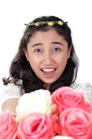 prom queen: Close up portrait of gorgeous Asian bride with bright smile, handing a roses bouquet toward camera, isolated on white background Stock Photo