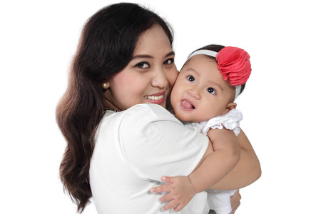 Happy Asian mother hugging her cute baby daughter, isolated on white background
